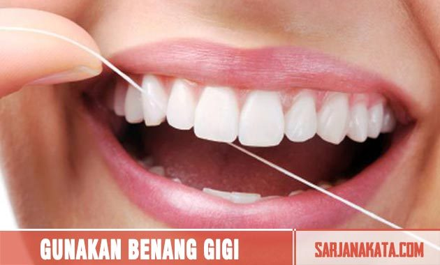Menggunakan Benang Gigi